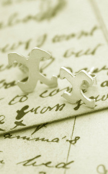 Single kiss silver studs by Nicola Crawford Jewellery Product photo