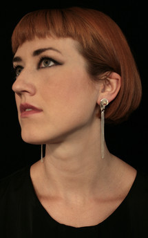 Volute silver tassel studs by Cara Tonkin Jewellery Product photo